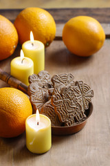 Bowl of christmas cookies among aromatic oranges and yellow cand