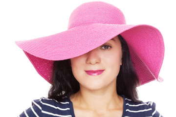 Young beautiful woman in a summer hat