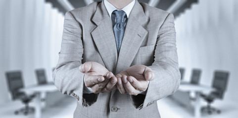 business man with an open hand as showing something
