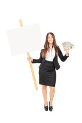 Businesswoman holding money and a blank banner