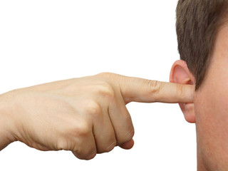 man clog his ears with fingers