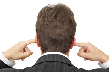 businessman blocking his ears with fingers . .deaf manager conce