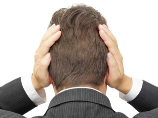businessman blocking his ears with hands