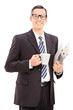 Businessman holding a newspaper and coffee