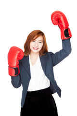 Success Asian businesswoman with boxing glove