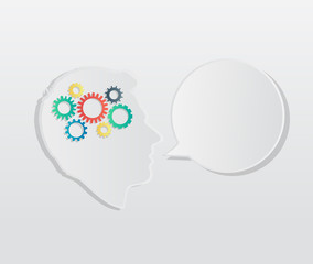 Head with cogs and wheels for brain and speech bubble