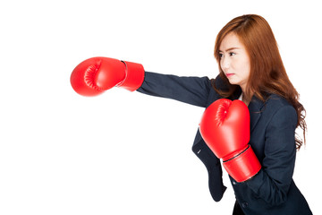 Asian businesswoman punch with boxing glove