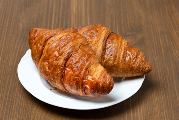 fresh croissants on a plate