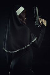 Nun with gun