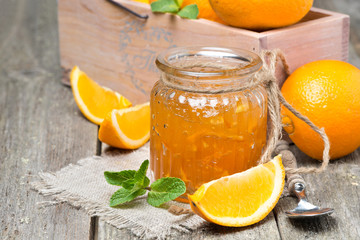 orange marmalade in a glass jar, horizontal