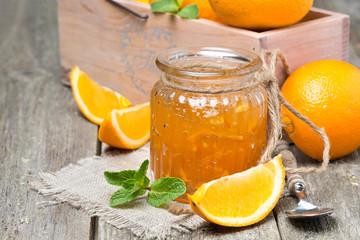 orange marmalade in a glass jar, horizontal
