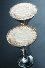 two-layer chocolate dessert in glasses, vertical