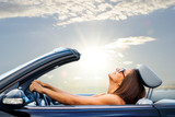 Fototapety Young girl driving convertible