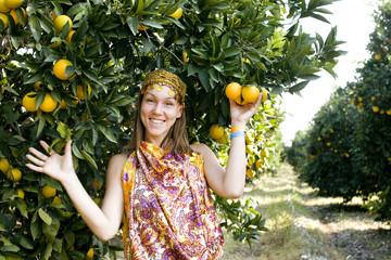 pretty woman in orange grove smiling