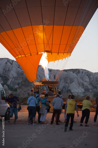 Deurstickers Ballon Cappadocia - preparations to the start of the balloon at sunrise