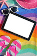 Tablet with blank screen on beach towel with accessories - 68115930