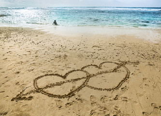 Hearts on sand near ocean