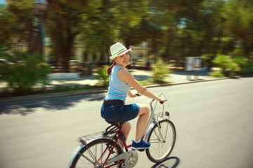 Happy young woman cycling