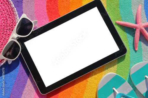 Tablet with blank screen on beach towel with accessories - 68116178