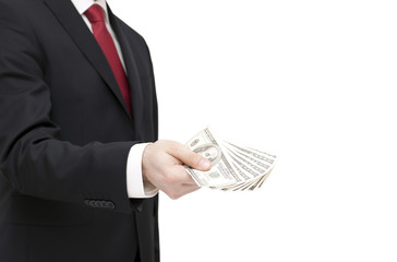 Businessman holding dollars. Clipping path included.