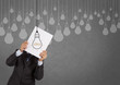 businessman showing the book of drawing idea light bulb concept