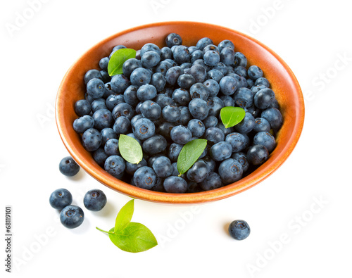 blueberries in a clay bowl