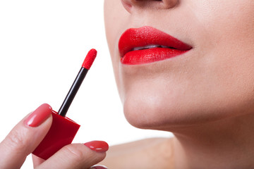 Painting lips with red lipstick