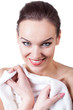Smiling woman with white towel