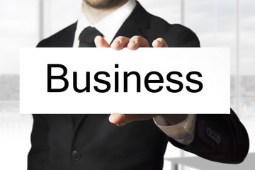 businessman holding sign business