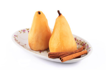 Poached pears in syrop with cinnamon isolated
