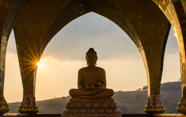 Buddha in sun set time