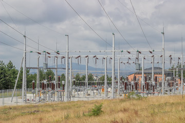 power substation with circuit switcher, regulators, reclosers an