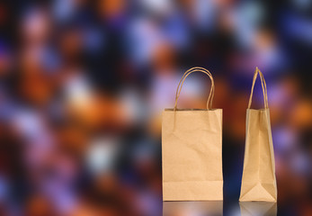 Brown paper bag on bokeh background
