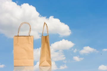 Brown paper bag on sky background