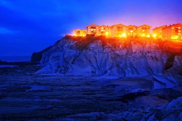 houses on cliff near the sea