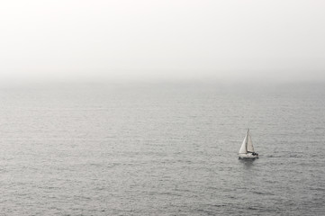 lonely sailboat on water