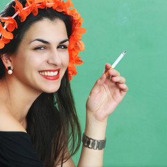 Young woman with cigarettes