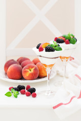 Cream cheese, biscuits, peaches and fresh berries dessert