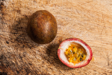 Passion fruits on wooden background.