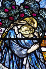 Two grieving children in stained glass