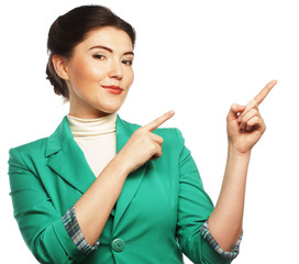 Happy business woman pointing an idea