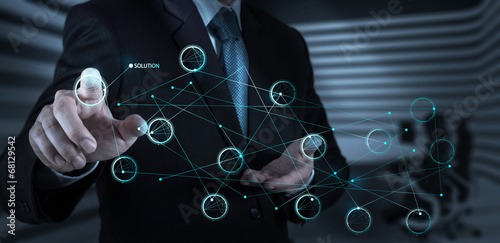 businessman hand pushing solution diagram on a touch screen inte - 68129542