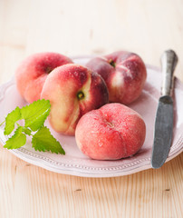 ripe juicy chinese flat peaches or Saturn peaches