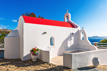 White small chapel with red roof in Mykonos