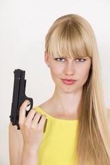 Cute confident policewoman holding gun