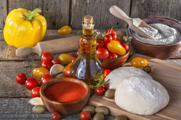 Dough for Italian pasta with tomato, olive oil and vegetables