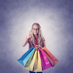 Girl with rainbow coloured Shopping bags