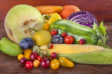 Fresh fruits and vegetables on a wooden background