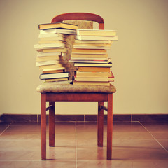 books on a chair, with a retro effect