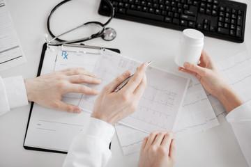 two doctors prescribing medication